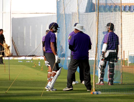 Cheteshwar Pujara and Harbhajan bat in the nets as coach Duncan Fletcher looks on