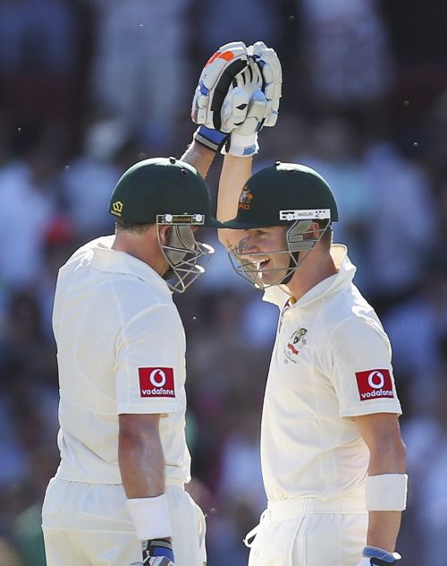 Australia's captain Michael Clarke (R) congratulates teammate Mike Hussey on reaching his century during the second cricket Test match against South Africa