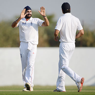 Monty Panesar of England celebrates with Alastair Cook