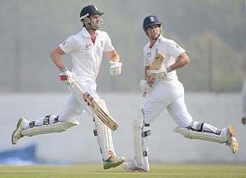 Alastair Cook and Nick Compton of England run between the wickets