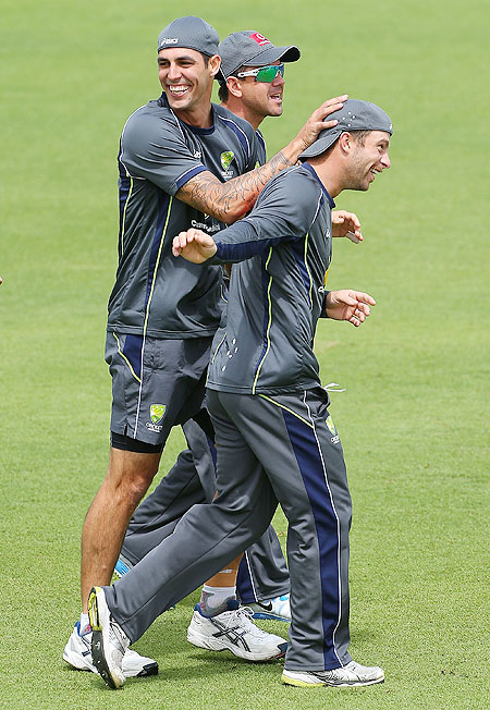Mitchell Johnson and Matthew Wade celebrate winning a warm up game during an Australian training session at WACA, Perth on Wednesday