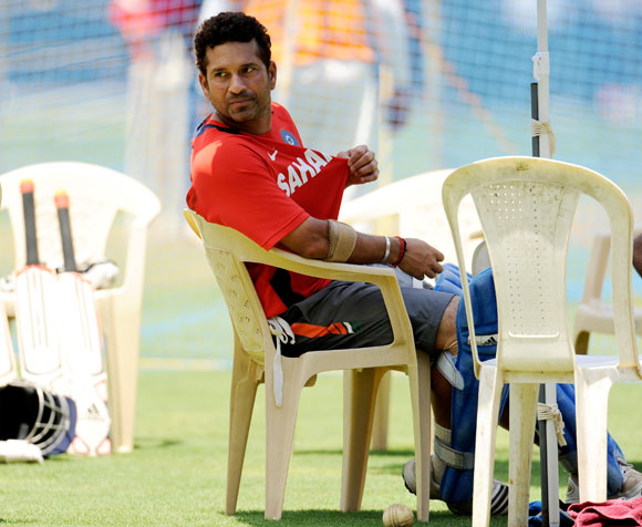 India's Sachin Tendulkar looks on as he takes a break during a training session at the Wankhede Stadium