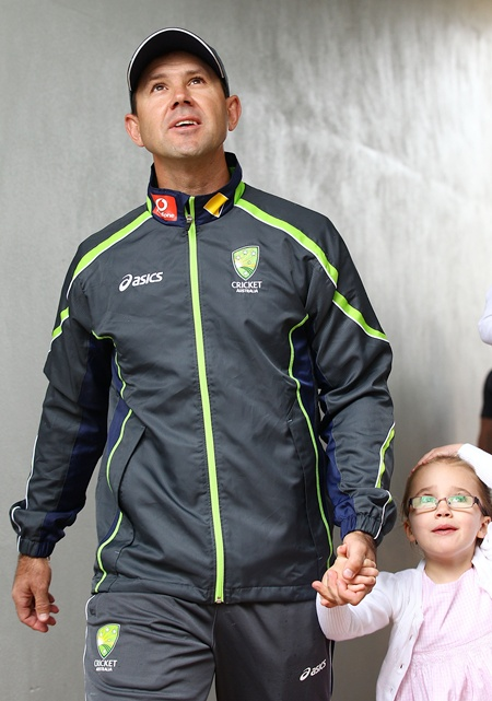 Australian cricket player Ricky Ponting walks with his daughter