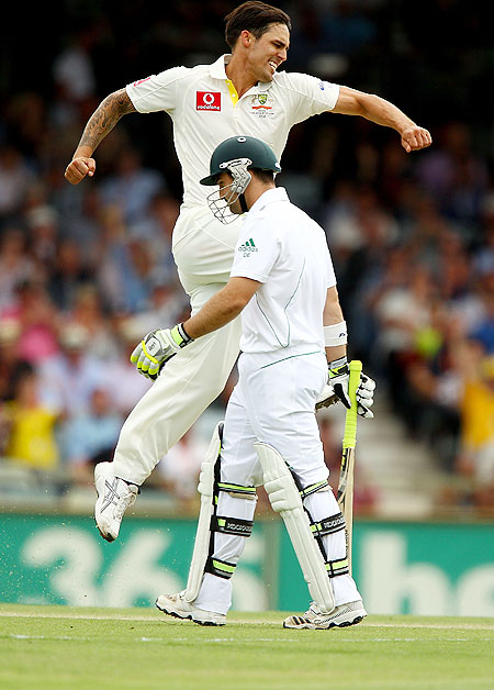 Australia's Mitchell Johnson celebrates the wicket of Dean Elgar of South Africa on day 1 of the Third Test between Australia and South Africa at WACA