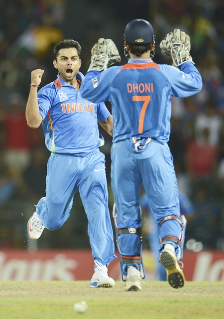 India's Virat Kohli (left) celebrates with Mahendra Singh Dhoni