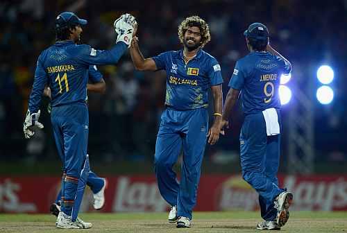 Lasith Malinga of Sri Lanka celebrates with Kumar Sangakkara and Jeevan Mendis after bowling Samit Patel of England during the ICC World Twenty20 2012 Super Eights Group 1 match between Sri Lanka and England
