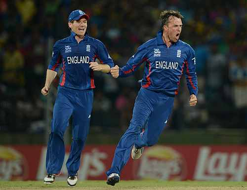 Graeme Swann of England celebrates with Eoin Morgan after dismissing Kumar Sangakkara of Sri Lanka during the ICC World Twenty20 2012
