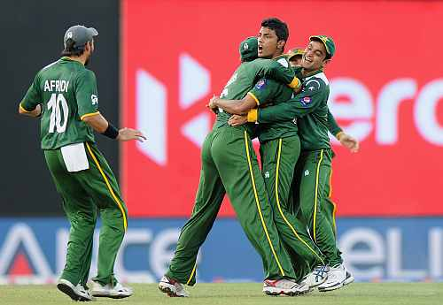 Raza Hasan is congratulated by teammates after dismissing Shane Watson during the ICC World Twenty20