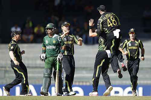 Australia's players celebrate dismissal of Pakistan's captain Mohammad Hafeez during their Twenty20 World Cup Super 8 match in Colombo