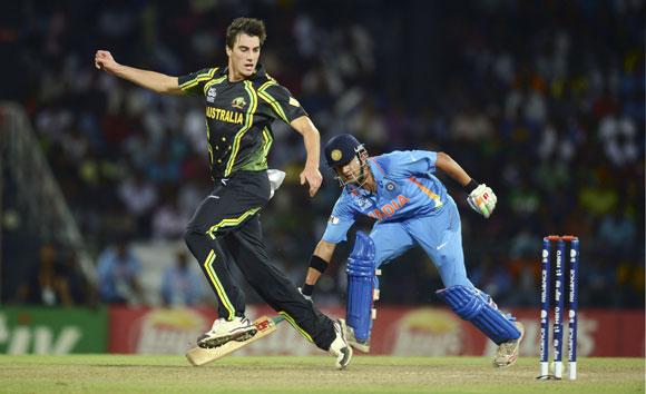 Australia's Pat Cummins (left) runs out India's Gautam Gambhir