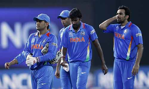 India's captain MS Dhoni leads his men off the field