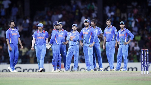 India's players stand on the field