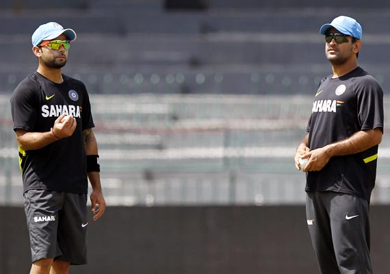 Mahendra Singh Dhoni (right) with Virat Kohli