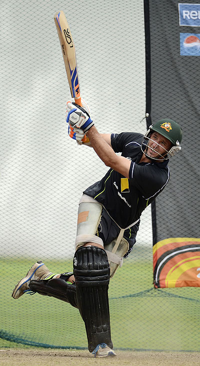 Australia's Michael Hussey hits out during a training session at Colts cricket ground