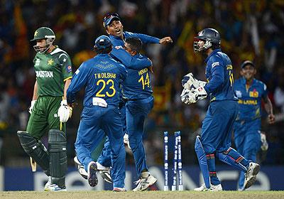 Rangana Herath of Sri Lanka celebrates with Mahela Jayawardene after bowling Shahid Afridi
