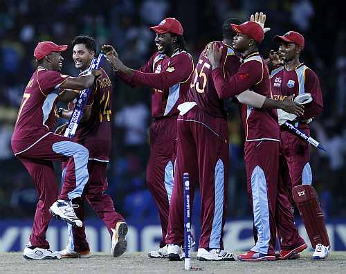West Indies players celebrate after they won their Twenty20 World Cup semi-final match against Australia in Colombo