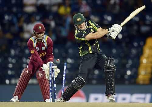 Australia's Shane Watson is bowled as West Indies' Denesh Ramdin looks on during the ICC world Twenty20 semi-final at the R Premadasa Stadium, Colombo