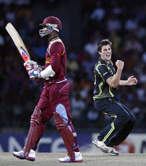 Australia's Pat Cummins celebrates after taking the wicket of West Indies Marlon Samuels during their Twenty20 World Cup semi-final match in Colombo