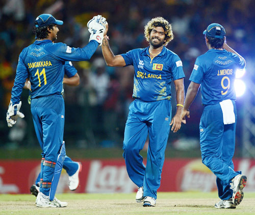 Lasith Malinga of Sri Lanka celebrates with Kumar Sangakkara and Jeevan Mendis