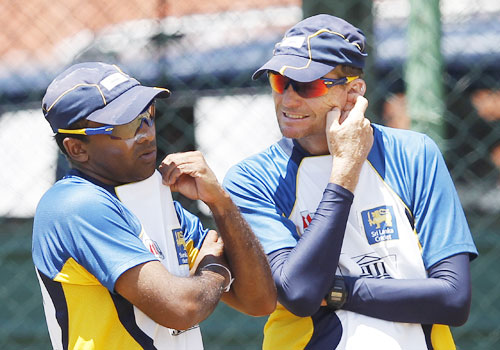 Sri Lanka's captain Mahela Jayawardene (left) talks with coach Graham Ford