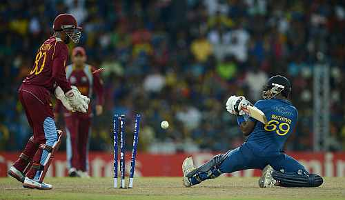 Angelo Mathews of Sri Lanka is bowled by Darren Sammy of the West Indies during the ICC World Twenty20 2012 Final between Sri Lanka and the West Indies