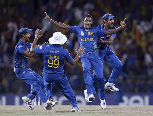 Sri Lanka's Ajantha Mendis celebrates with his teammates after taking the wicket of West Indies Gayle during their Twenty20 World Cup final match in Colombo