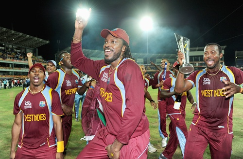 Dwayne Bravo, Chris Gayle and Dwayne Smith of the West Indies celebrate