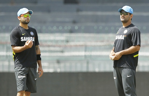 India's captain Mahendra Singh Dhoni (right) talks to Virat Kohli