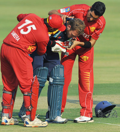 David Miller of Yorkshire receives attention after being struck by Umar Gul of Uva