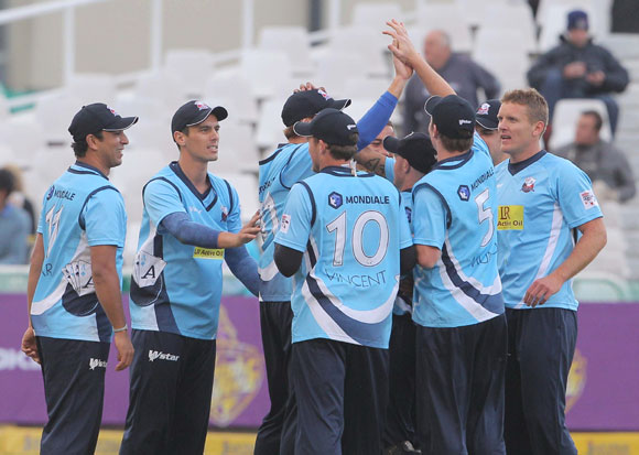 Auckland Aces team-mates celebrate during the CLT20 match against Kolkata Knight Riders