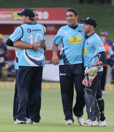 Auckland Aces team-mates celebrate