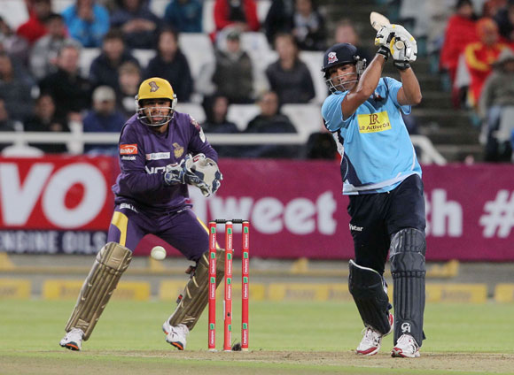 Azhar Mahmood of the Auckland Aces (right) bats during the CLT20 match against Kolkata Knight Riders