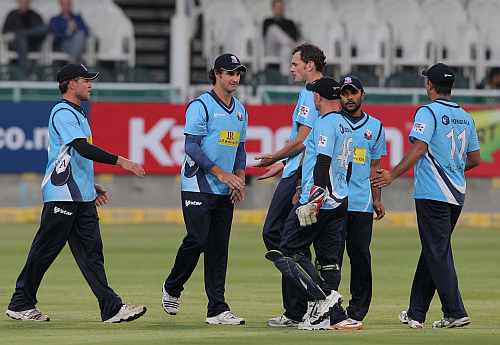 Auckland Aces celebrate after picking up a wicket