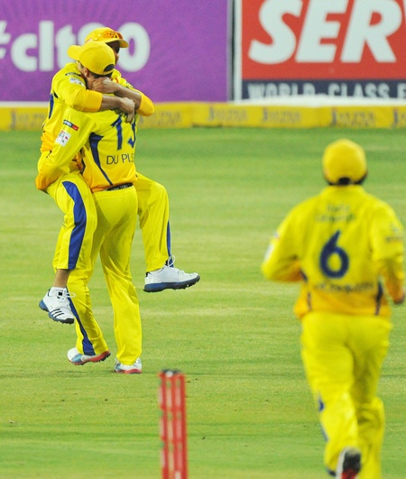Suresh Raina of Chennai Super Kings celebrates with teammate Faf du   Plessis