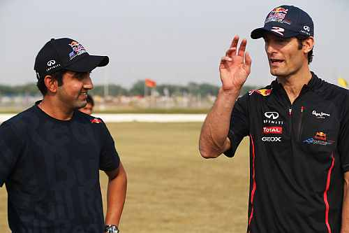 Mark Webber of Australia and Red Bull Racing meets Indian cricketer Gautam Gambhir during previews for the Indian Formula One Grand Prix