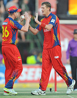Chris Morris of the Lions celebrates a wicket