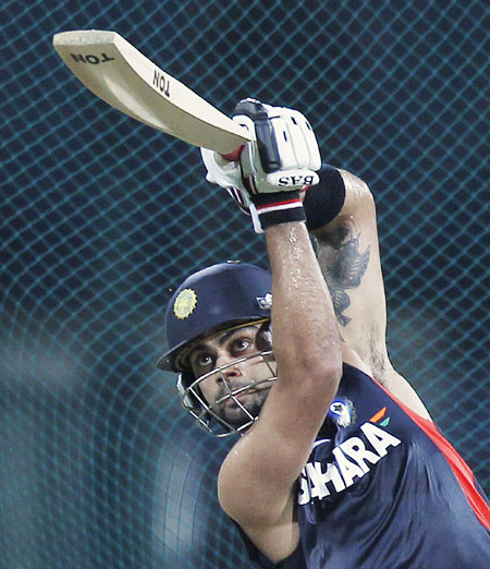 India's vice-captain Virat Kohli watches his sh