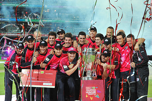 The Sydney Sixers celebrate with the trophy after winning the CLT20 final against Highveld Lions on Sunday