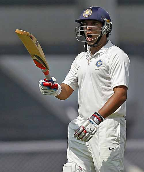 India 'A' team's Yuvraj Singh reacts as he walks back to the pavilion on the first day of the warm-up game against England in Mumbai
