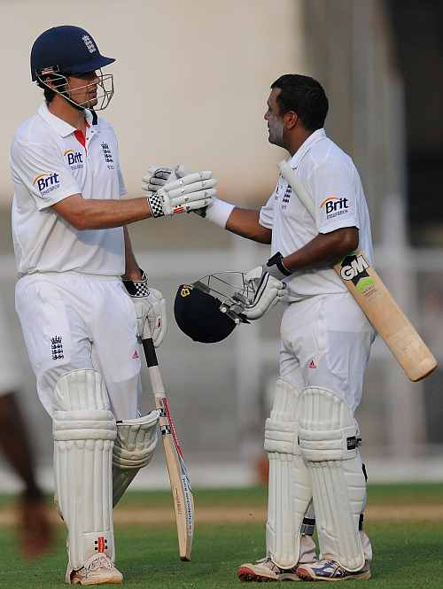 Samit Patel of England (R) and team captain Alastair Cook greet each other at the end of the days play