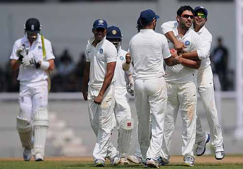 Yuvraj Singh (2nd R) of India 'A' celebrates capturing the wicket of Kevin Pietersen (L) of England with team-mates during the second day of the opening tour match