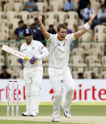 New Zealand's Tim Southee (R) appeals unsuccessfully for the wicket of India's Virender Sehwag