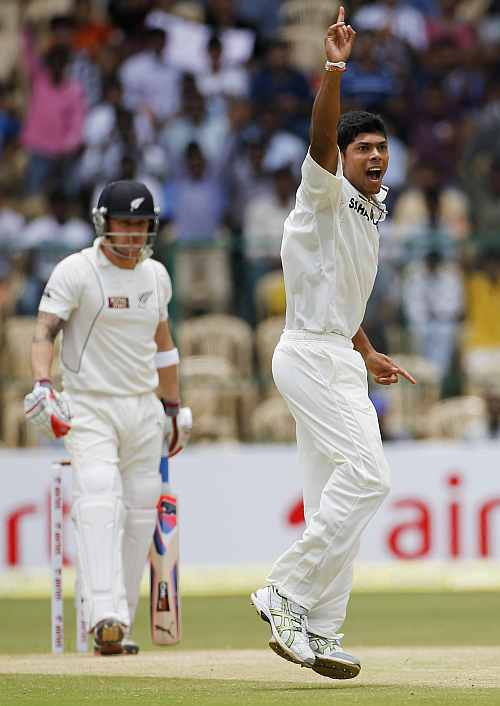 India's Umesh Yadav appeals successfully for wicket of New Zealand's McCullum during third day of their second Test match in Bangalore