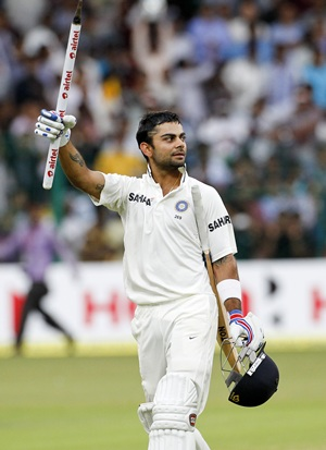 Virat Kohli celebrates after victory is clinched