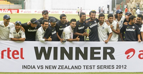 India's cricket team poses for a photo after they won the match and the series against New   Zealand