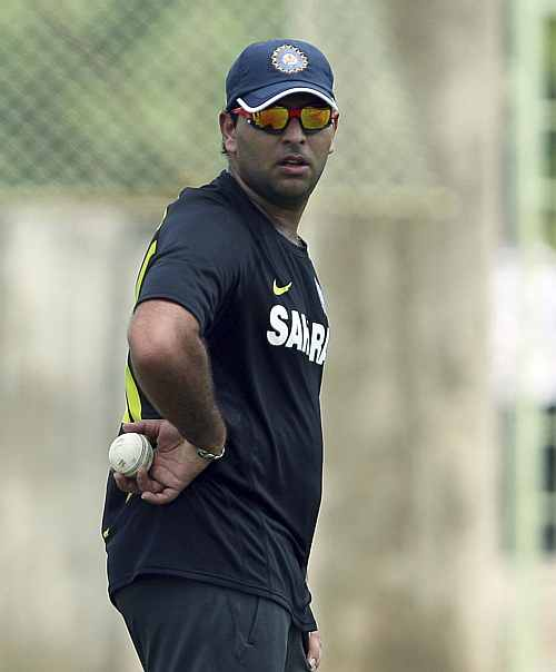 India's Yuvraj Singh holds a ball while standing in the nets during a practice session ahead of their first Twenty20 cricket match against New Zealand in Visakhapatnam