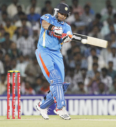 India's Suresh Raina hits a shot during their second Twenty20 cricket match against New Zealand in Chennai