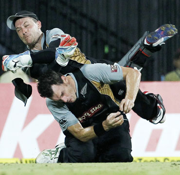 New Zealand's wicketkeeper Brendon McCullum (top) collides with teammate Kyle Mills as he attempts to take a catch to dismiss India's Yuvraj Singh during their second Twenty20 cricket match in Chennai