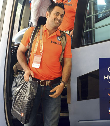 India's captain Mahendra Singh Dhoni (front) arrives at a hotel ahead of the World Twenty20 cricket series in Colombo