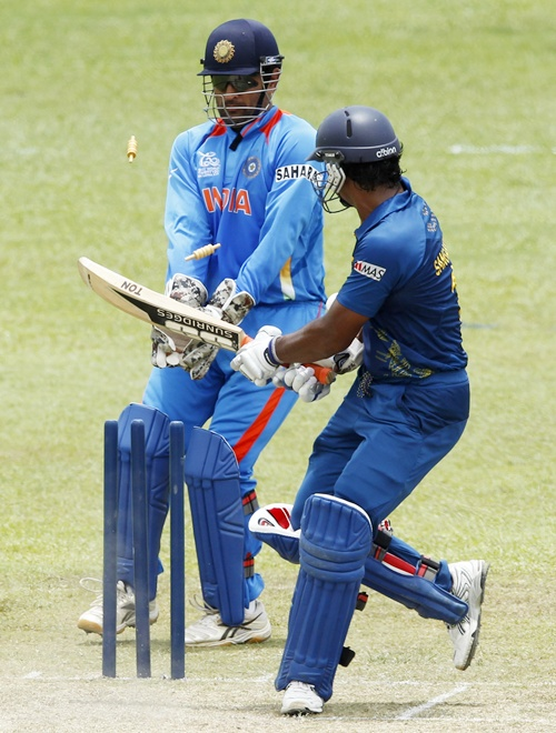 Sri Lanka's Kumar Sangakkara (right) bowled out by India's Harbhajan Singh